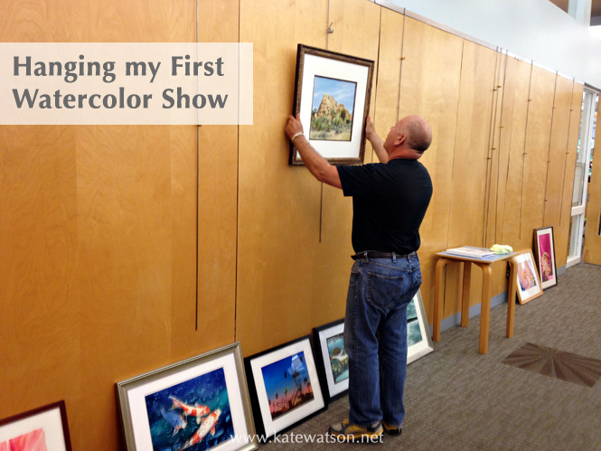 Guy hangs the first painting