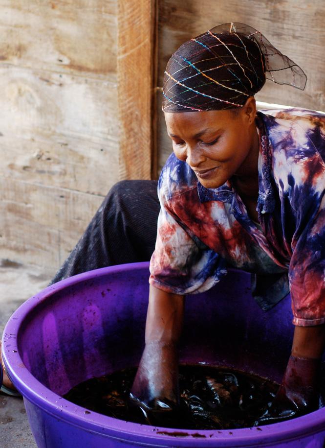 Global Mamas producer Mary Koomson batiking by hand